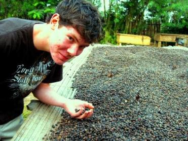 My son Ted with me on a return trip to Ivory Coast in 2009. His first time back in Ivory coast since his childhood. Coffee drying.