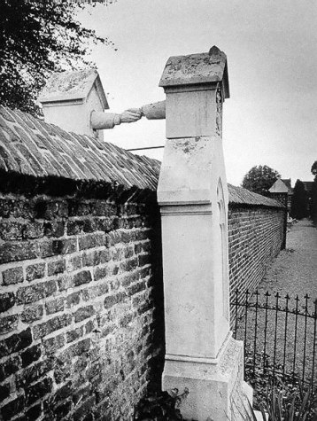 """Photo is attributed as, """"The Graves Of A Catholic Woman And Her Protestant Husband Seperated By A Wall, Holland, 1888."""""""