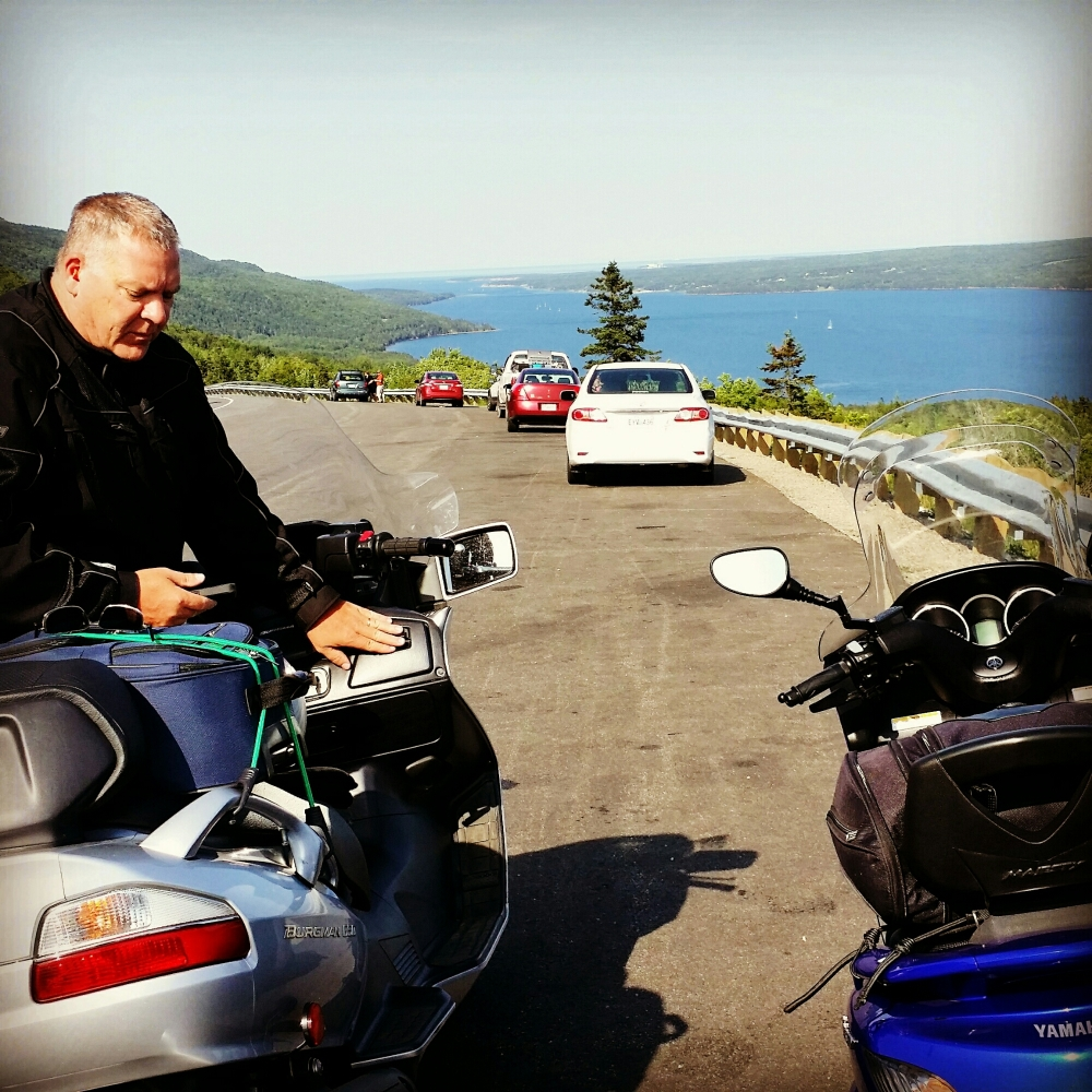 Cabot Trail in the highlands of Cape Breton, Nova Scotia. My buddy Milton with his Suzuki Burgman. He is 6:2